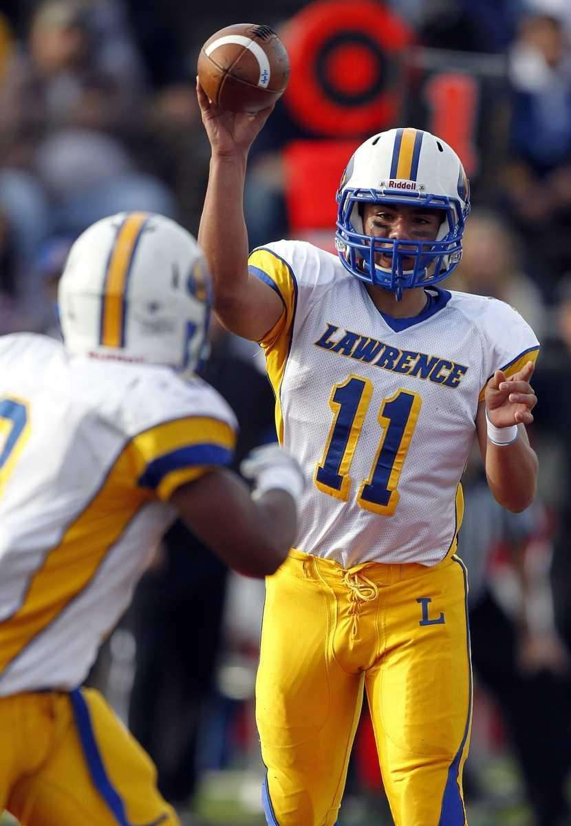 Lawrence quarterback Joe Capobianco (11) with the pass