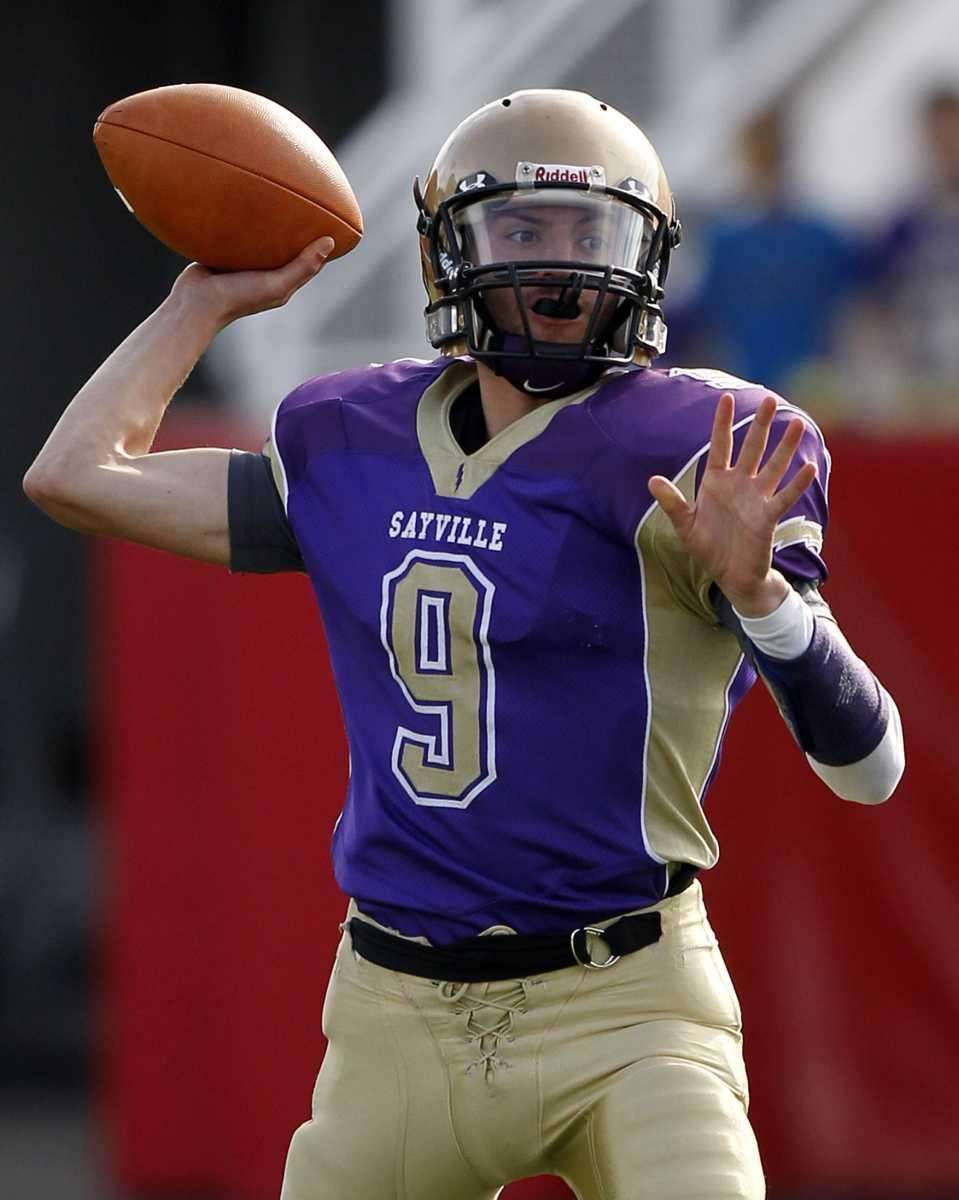 Sayville's quarterback Steven Ferreira (9) sets to throw