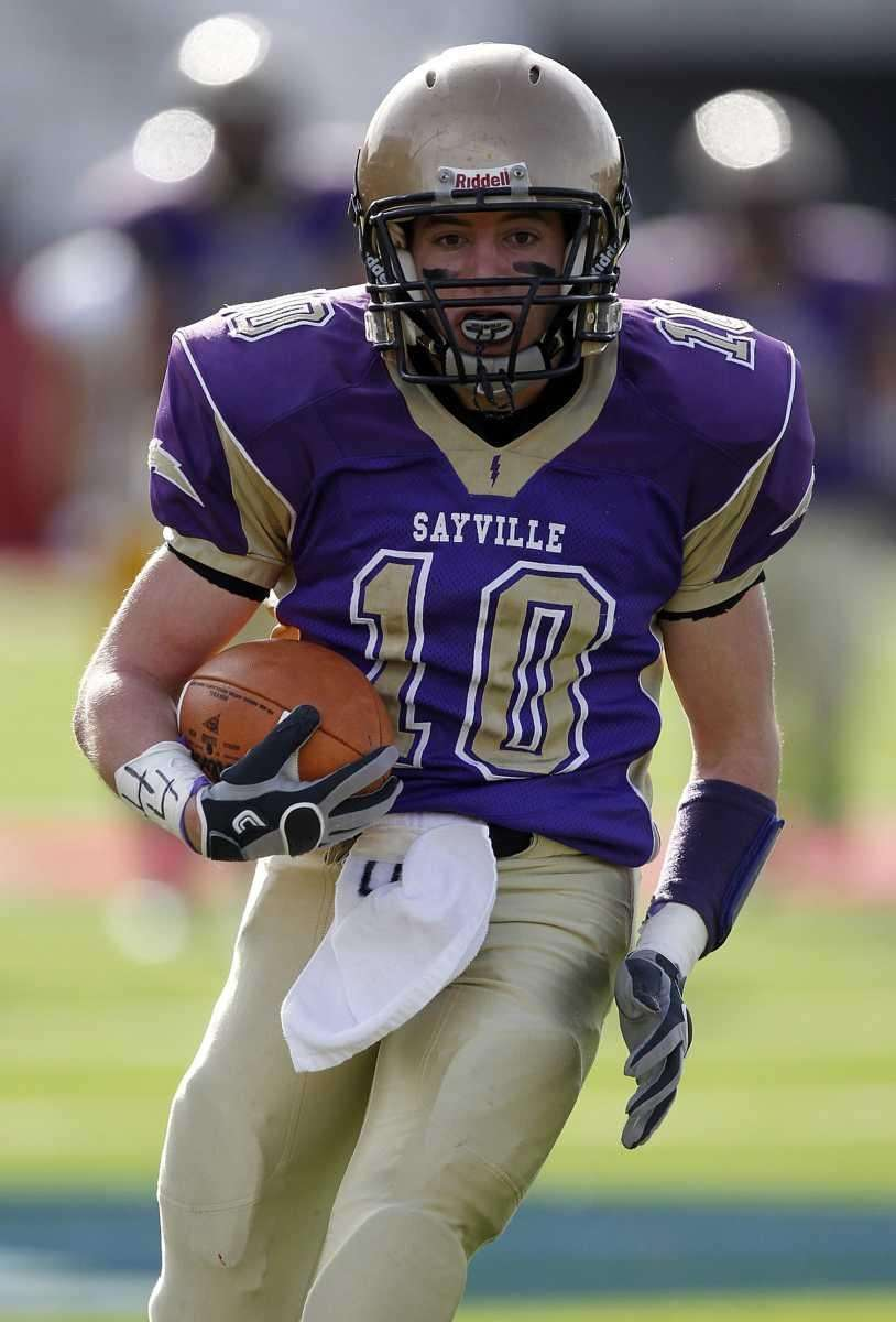 Sayville's Thomas Hannan (10) completes a pass reception