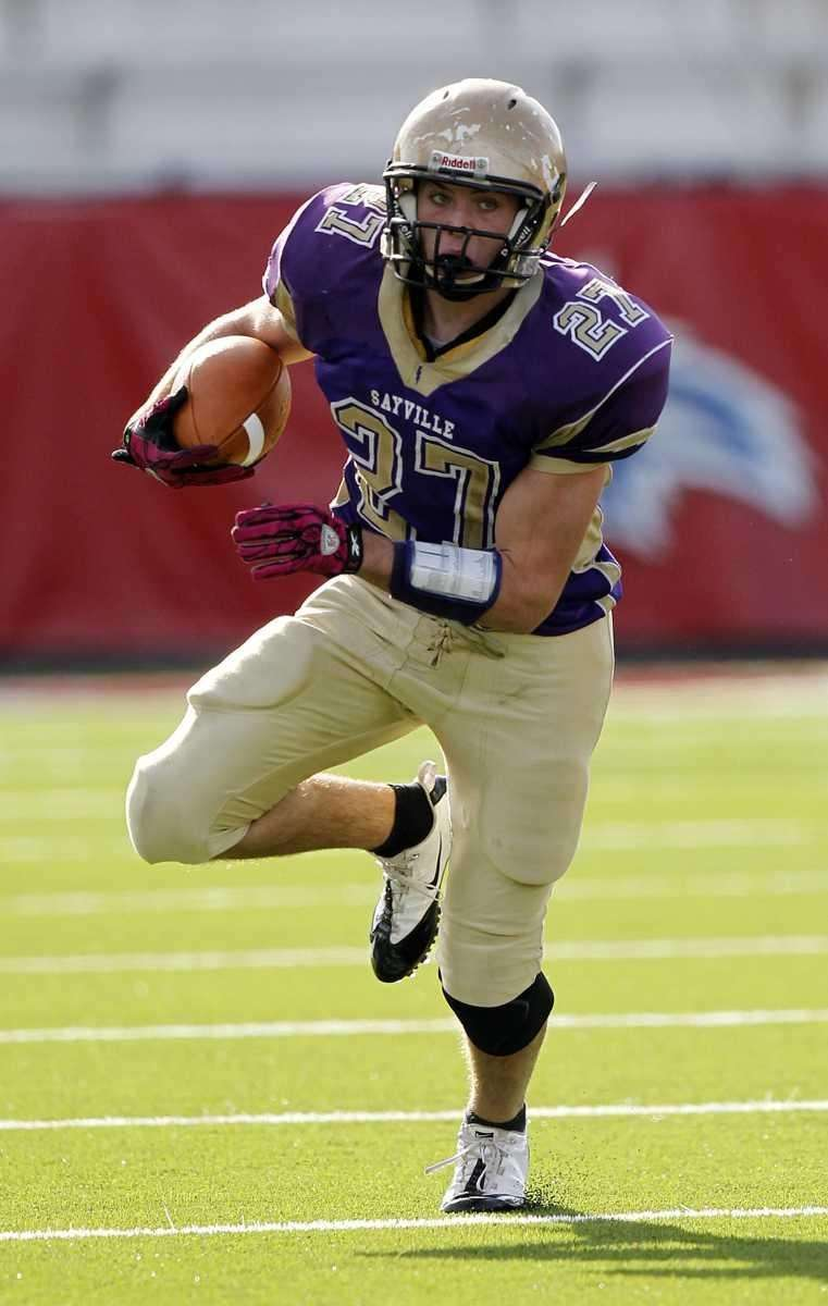 Sayville's John Haggart (27) runs around the right