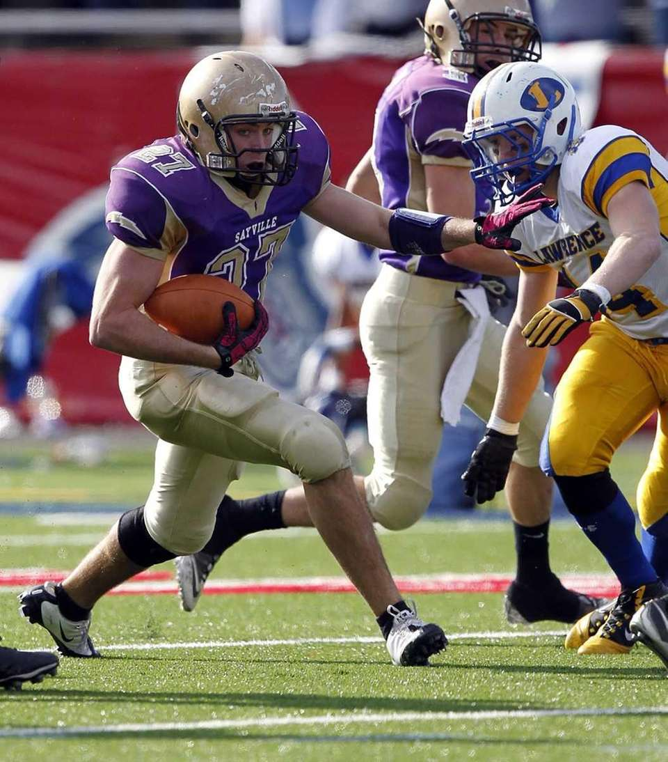 Sayville's John Haggart (27) breaks through the line