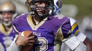 Sayville's Zach Sirico (32) on his way to