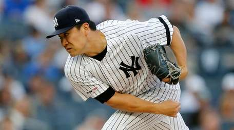 Masahiro Tanaka of the Yankees pitches during the