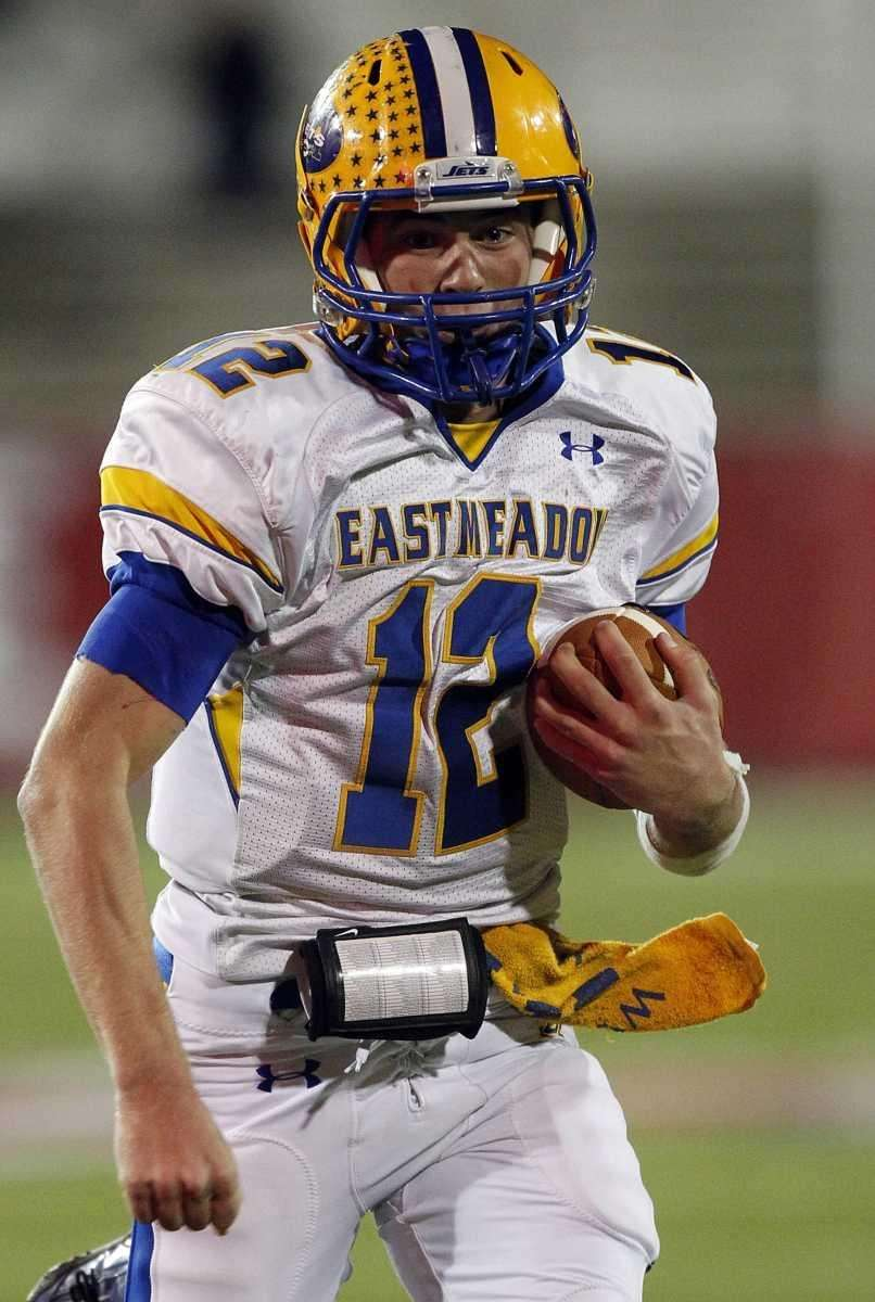 East Meadow quarterback Dylan Curry runs for a