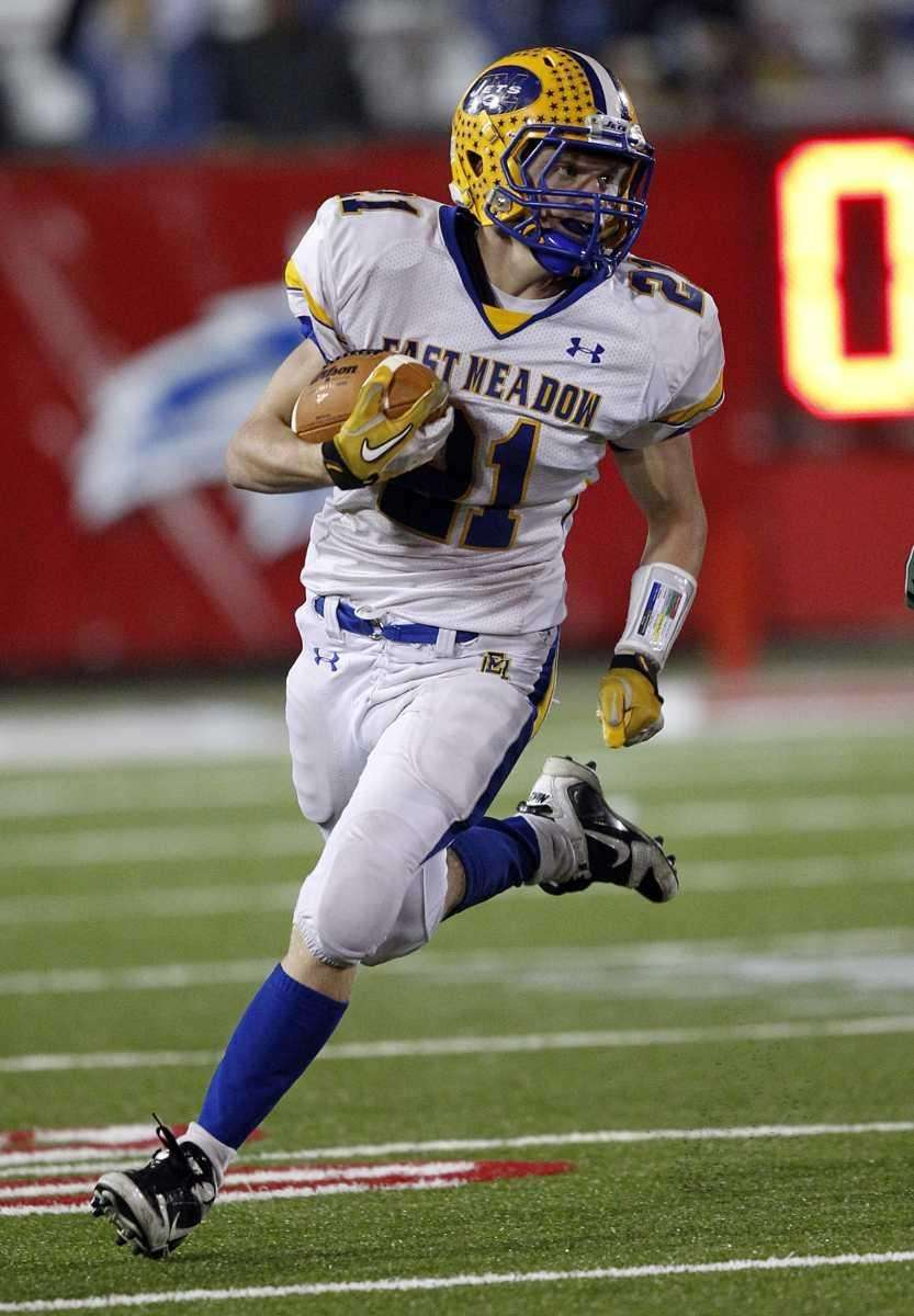 East Meadow running back Robbie Healy (12) with