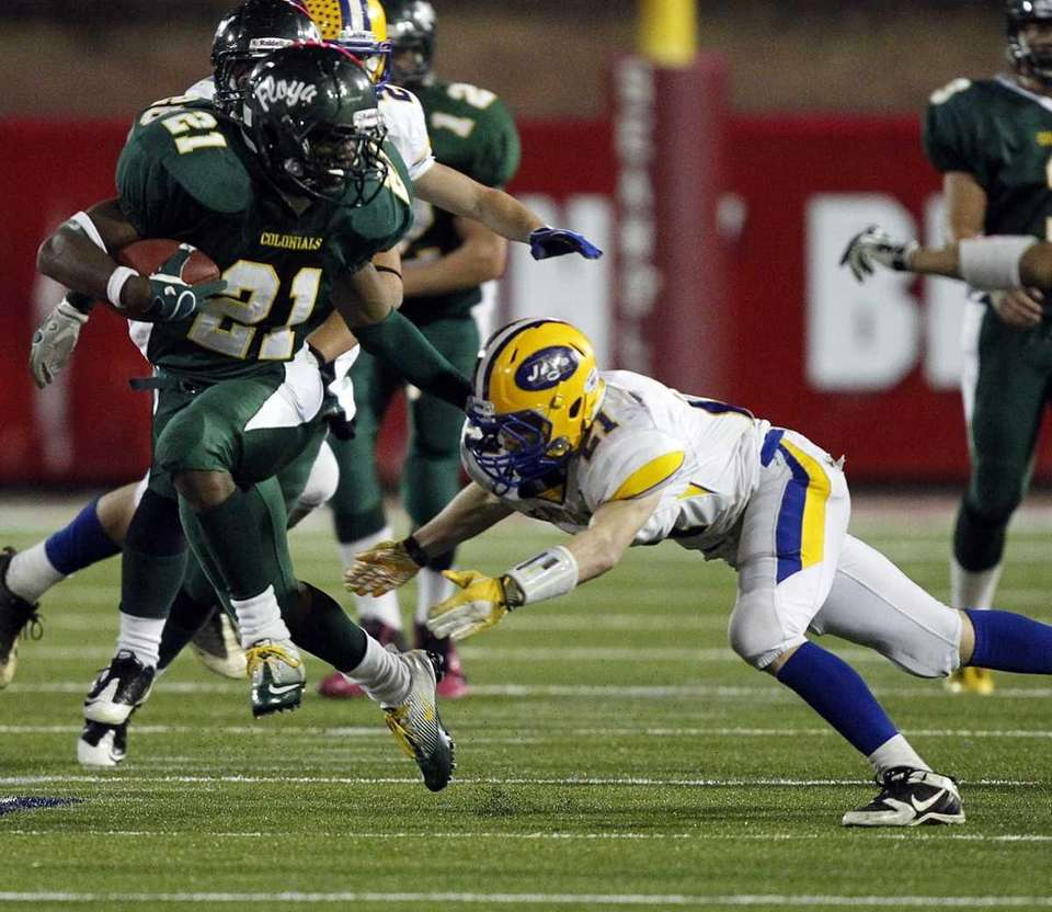 Floyd running back Stacey Bedell evades the tackle