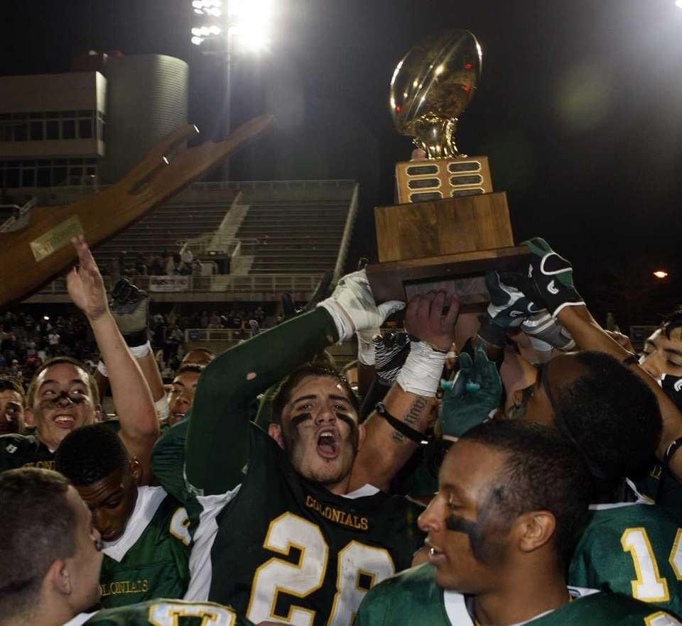 Members of the Floyd football team hoist the
