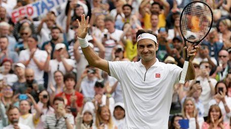 Switzerland's Roger Federer celebrates after beating Lucas Pouile
