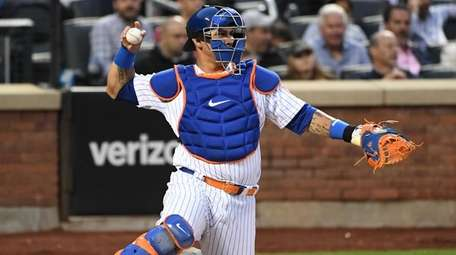 New York Mets catcher Wilson Ramos throws the