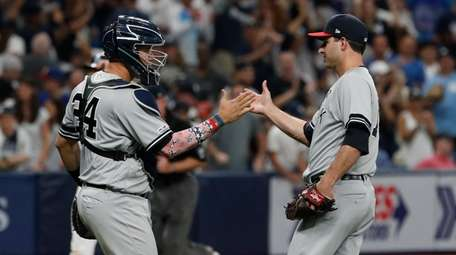 New York Yankees pitcher David Hale celebrates with