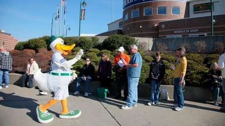 QuackerJack waves to fans waiting on line to