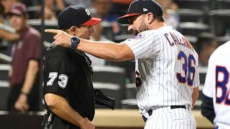 Mickey Callaway argues with umpire Tripp Gibson after