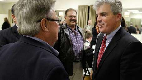 Newly elected Suffolk County Executive Steve Bellone, right,