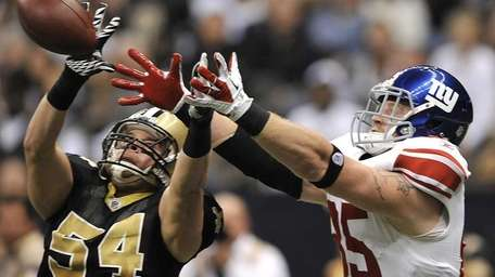 New Orleans Saints linebacker Will Herring (54) intercepts