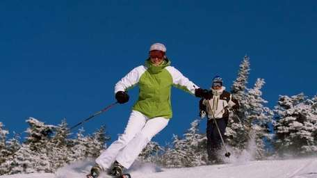 6. Stratton, Vt. Skiers enjoy a run from