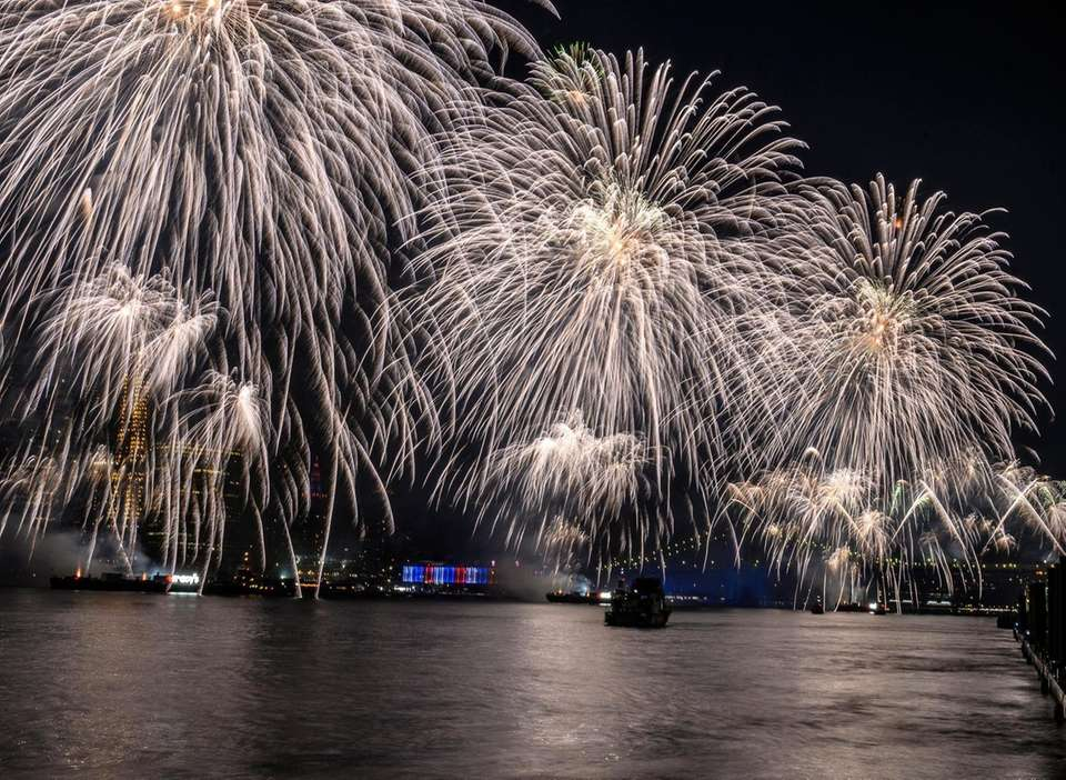 Fourth of July fireworks soar over the East