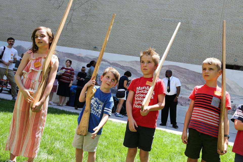 Children learn how to hold a bayonette in