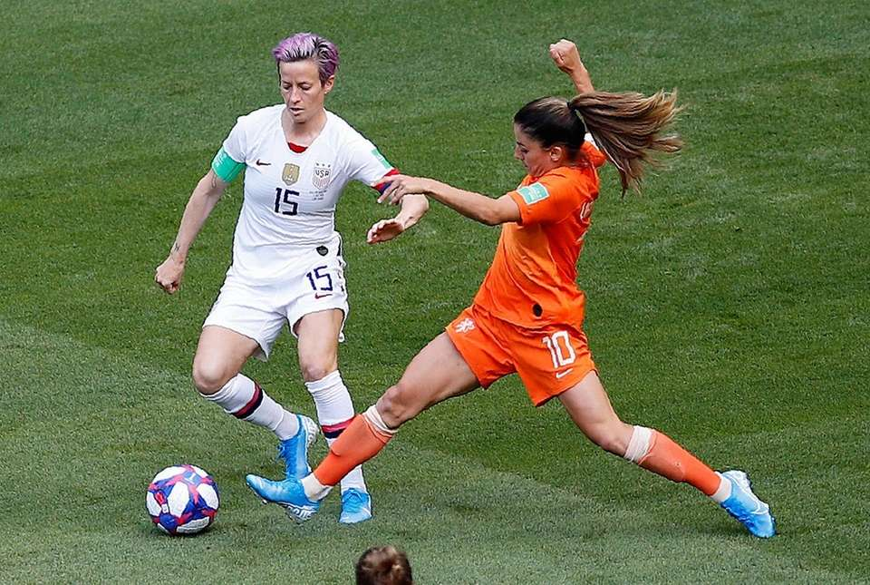 The United States' Megan Rapinoe, left, and the