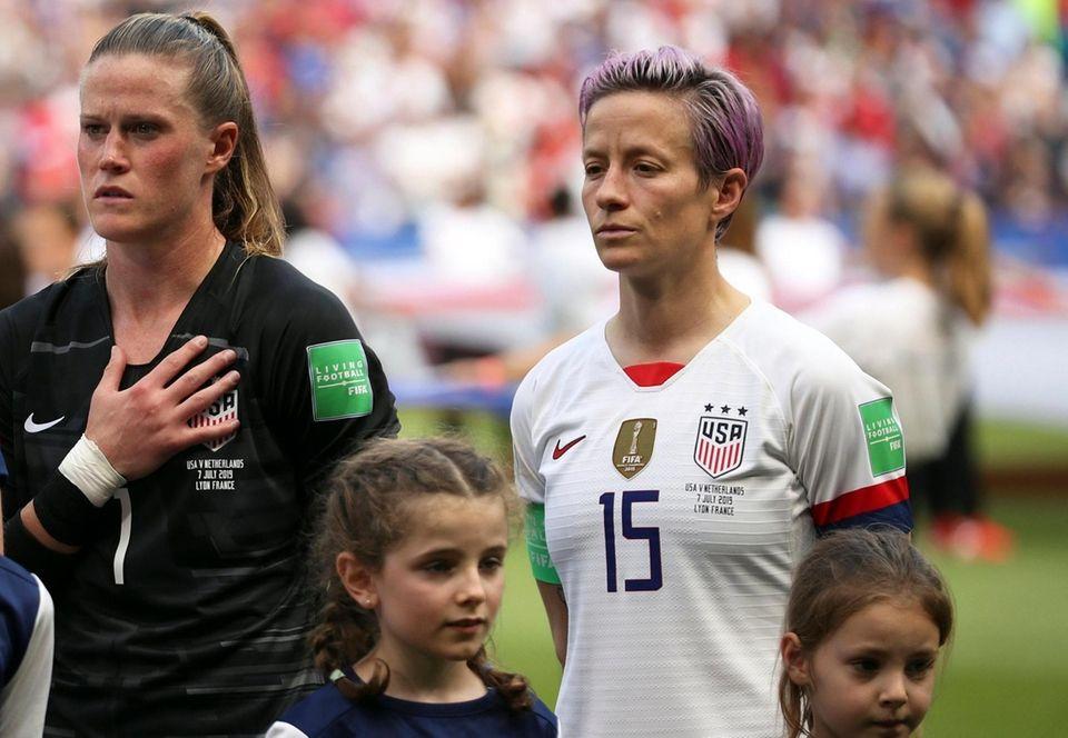 United States' Megan Rapinoe, right, and goalkeeper Alyssa