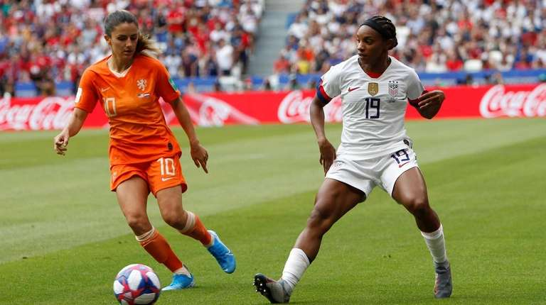 United States' Crystal Dunn, right, passes the ball