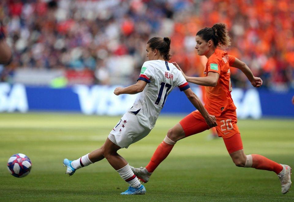 United States' Tobin Heath passes the ball as