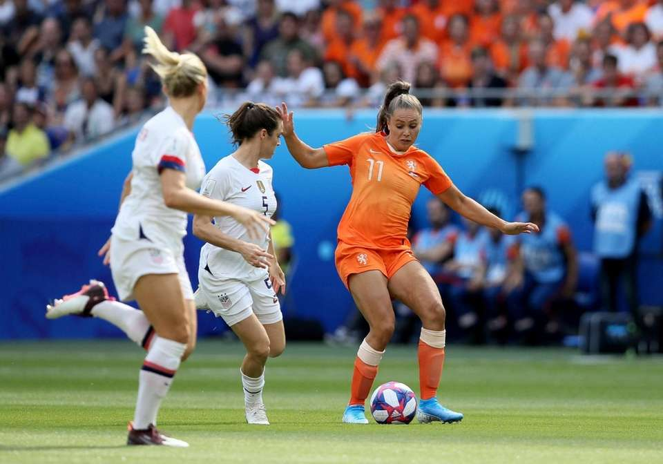 Netherlands' Lieke Martens, right, is challenged by United