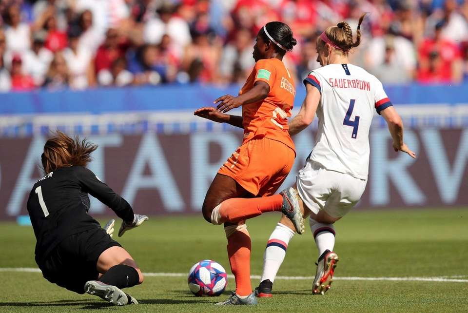 United States goalkeeper Alyssa Naeher dives for a