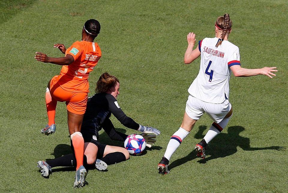 United States goalkeeper Alyssa Naeher , centre, makes