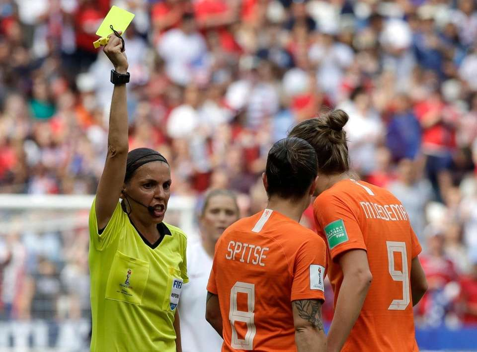 Netherlands' Vivianne Miedema, right, talks to French referee