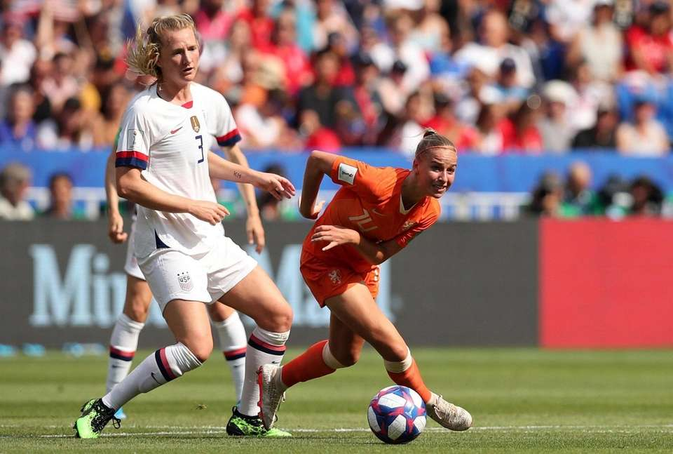 Netherlands' Jackie Groenen, right, controls the ball next