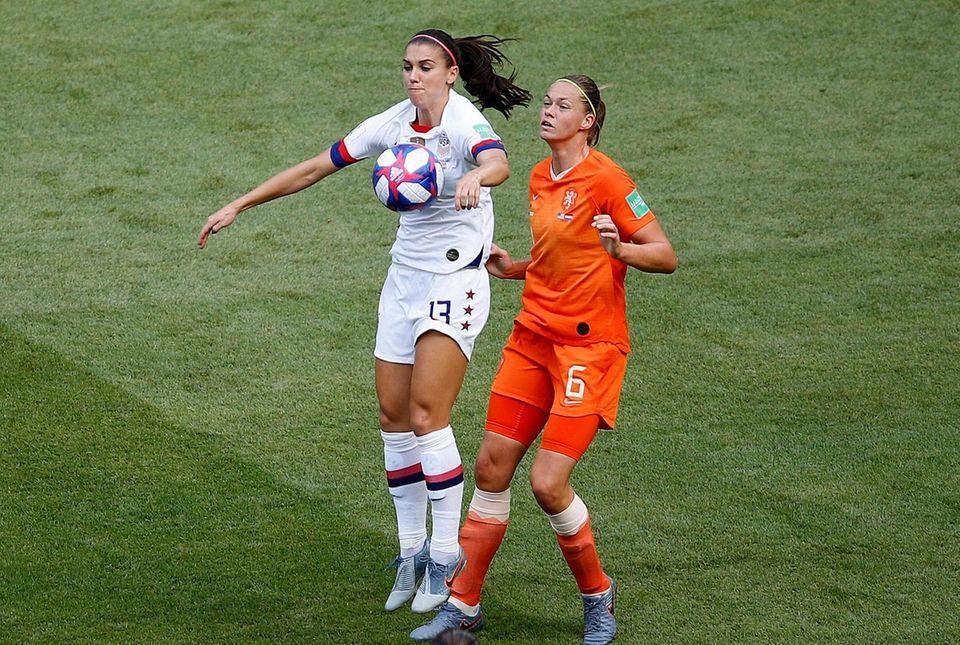 United States' Alex Morgan , left, and Netherlands'