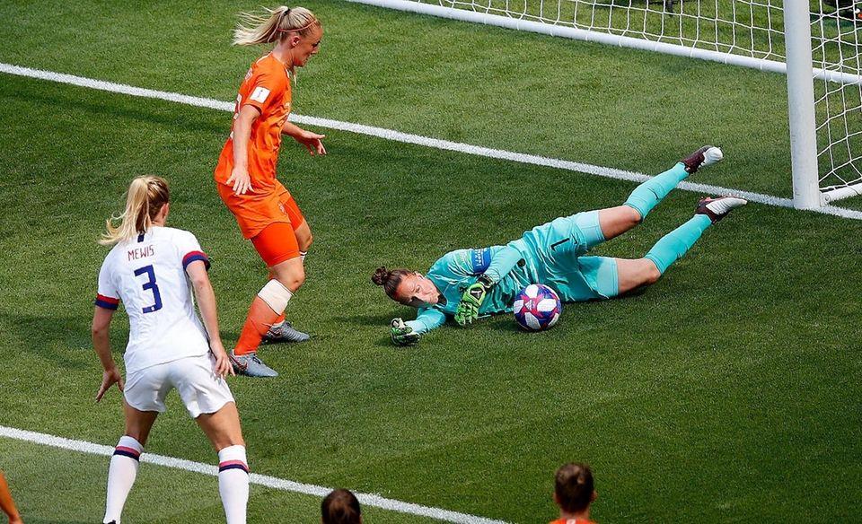 Netherlands goalkeeper Sari Van Veenendaal, right, makes a