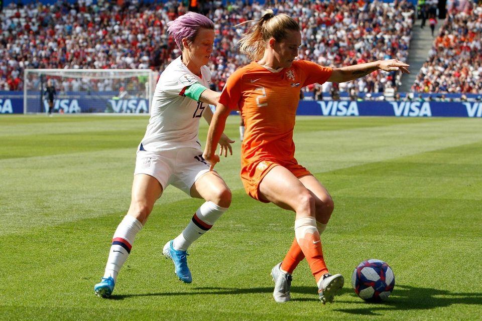 United States' Megan Rapinoe , left, chases Netherlands'