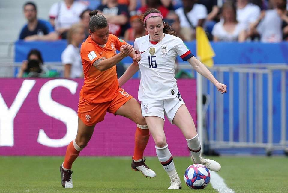 Netherlands' Sherida Spitse fights for the ball with