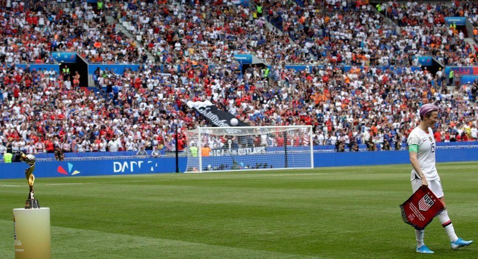 United States' Megan Rapinoe walks on pitch past