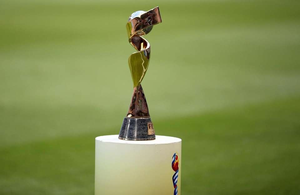 The trophy is displayed on the pitch before