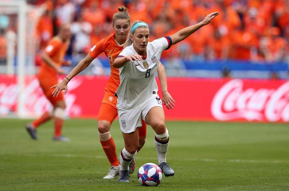 United States' Julie Ertz, right, runs with the