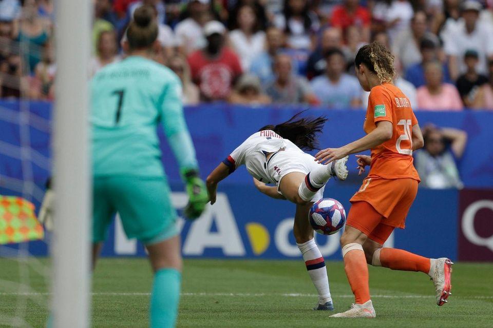 United States' Alex Morgan falls as Netherlands' Dominique
