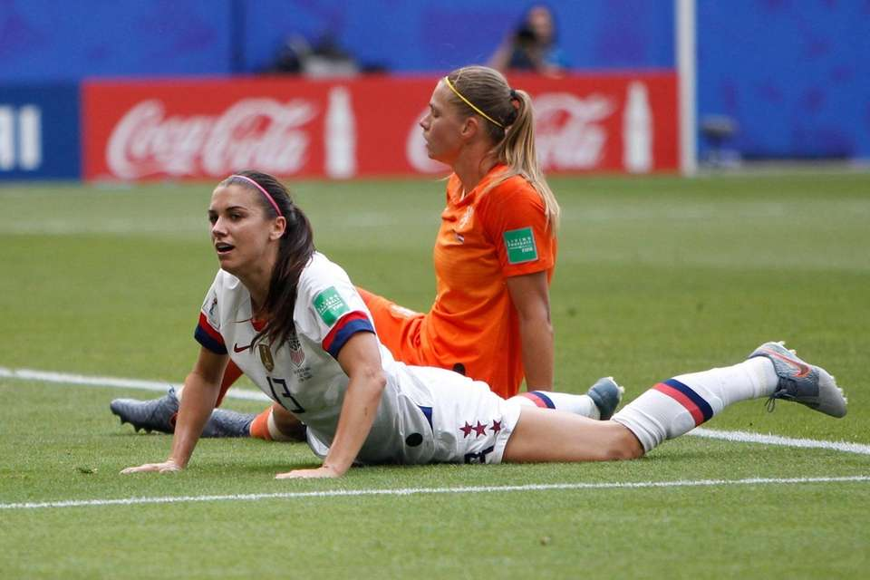 United States' Alex Morgan lies on the pitch