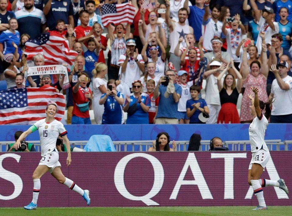 United States' Megan Rapinoe, left, celebrates with United