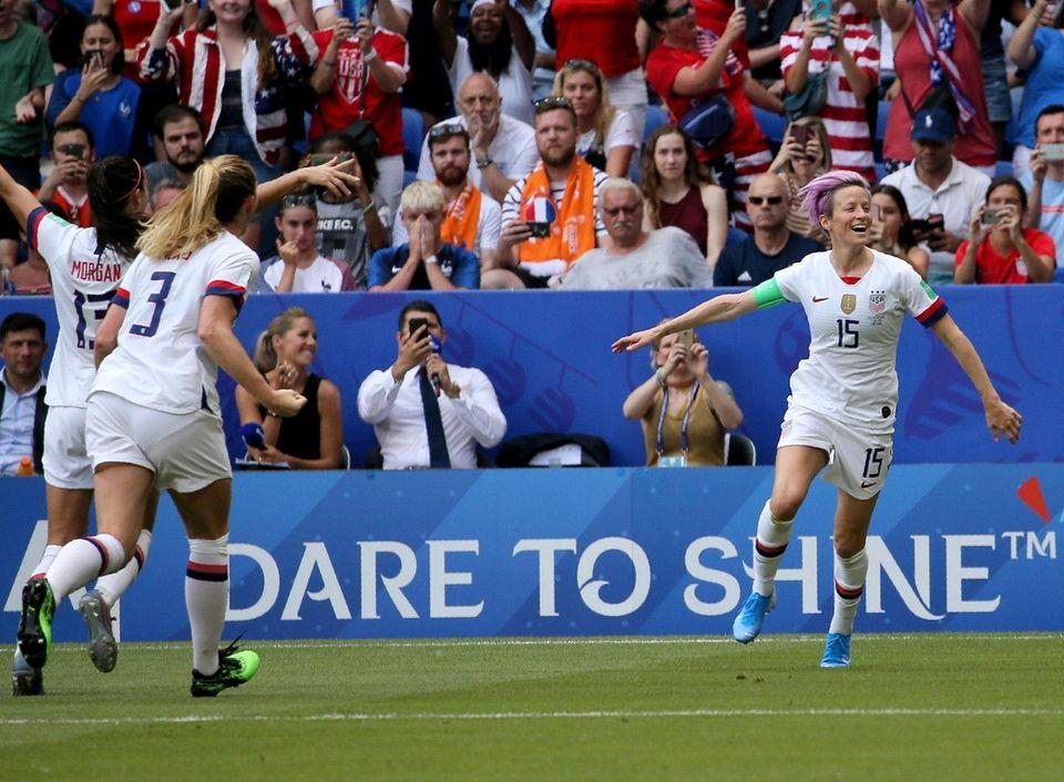 United States' Megan Rapinoe, right, celebrates after scoring