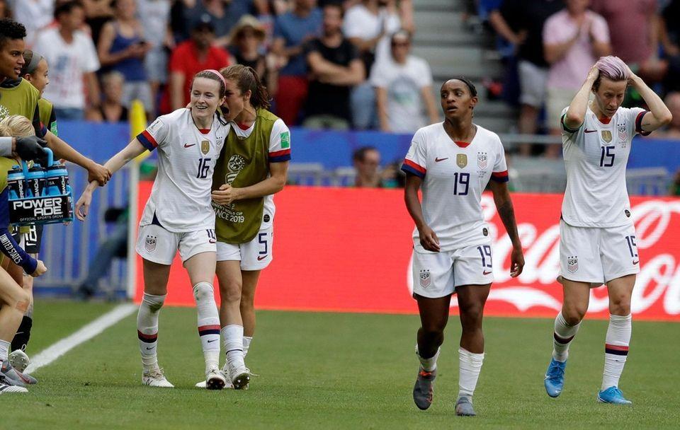 United States' Rose Lavelle, left, celebrates with teammates