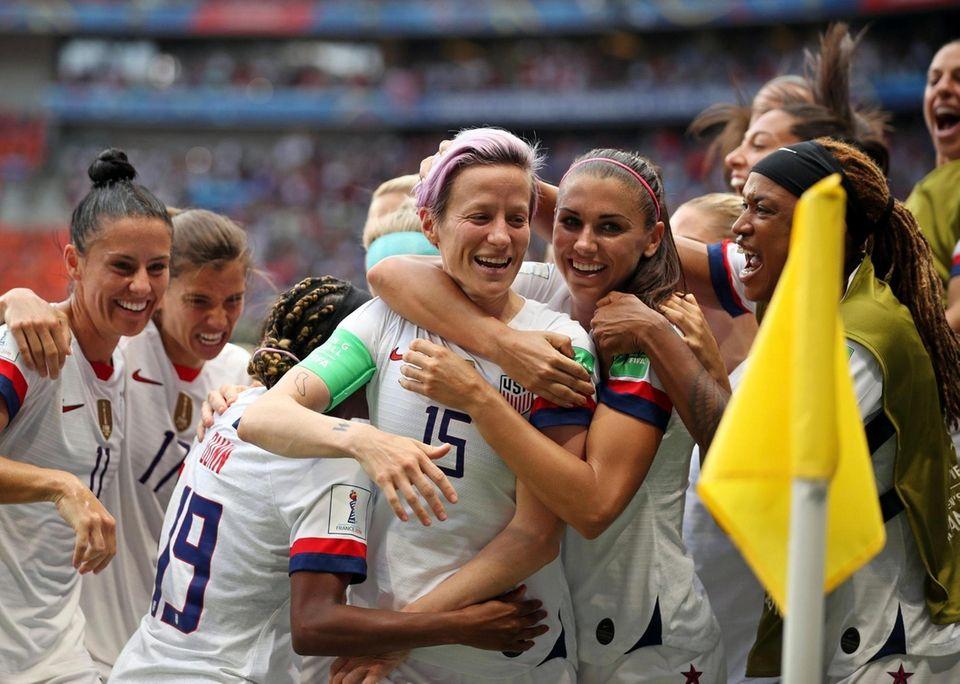 United States' Megan Rapinoe, center, celebrates after scoring