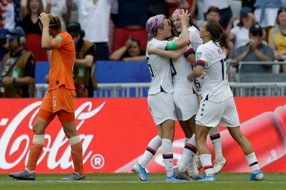 United States' Rose Lavelle, second right, celebrates with