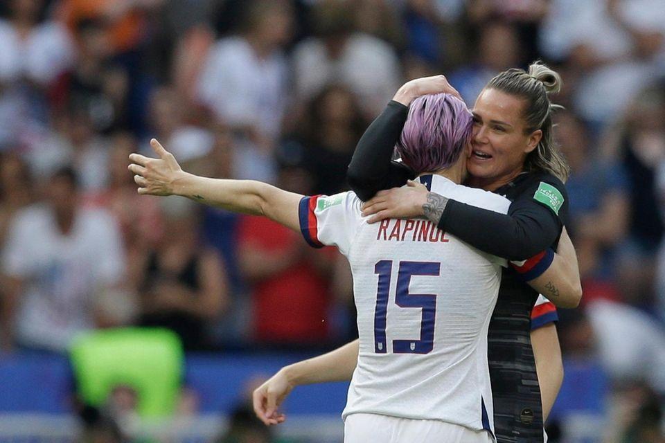 United States' Megan Rapinoe hugs United States goalkeeper