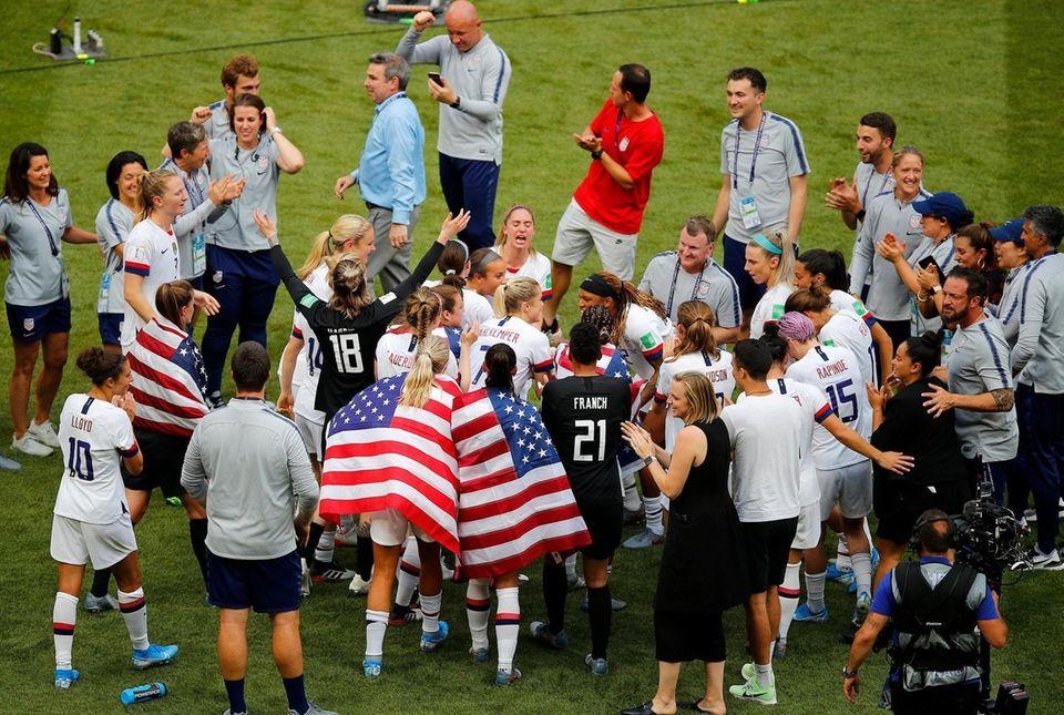 The US team celebrates winning the Women's World