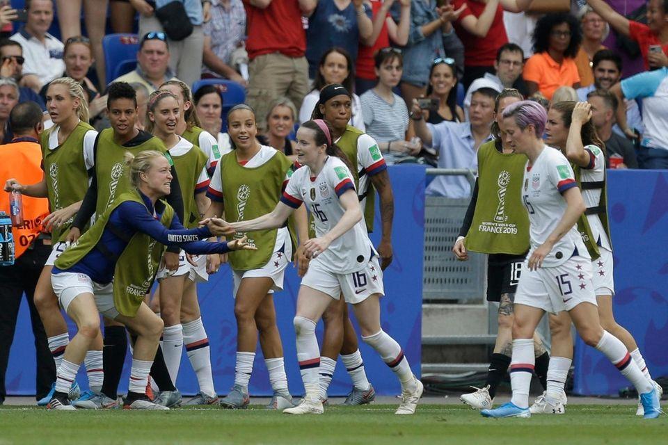 United States' Rose Lavelle, center, celebrates with teammates