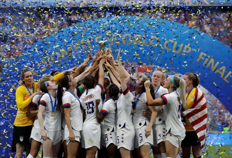 United States' team celebrates with trophy after winning