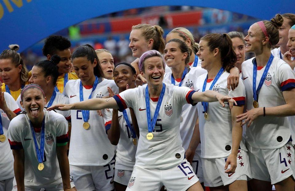 United States' Megan Rapinoe celebrates with teammates after