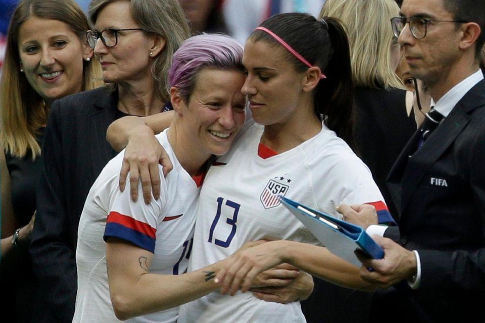 United States' Megan Rapinoe , left; and United